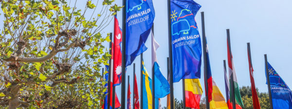 Photo: Flags of different countries and the CARAVAN SALON © Messe Düsseldorf